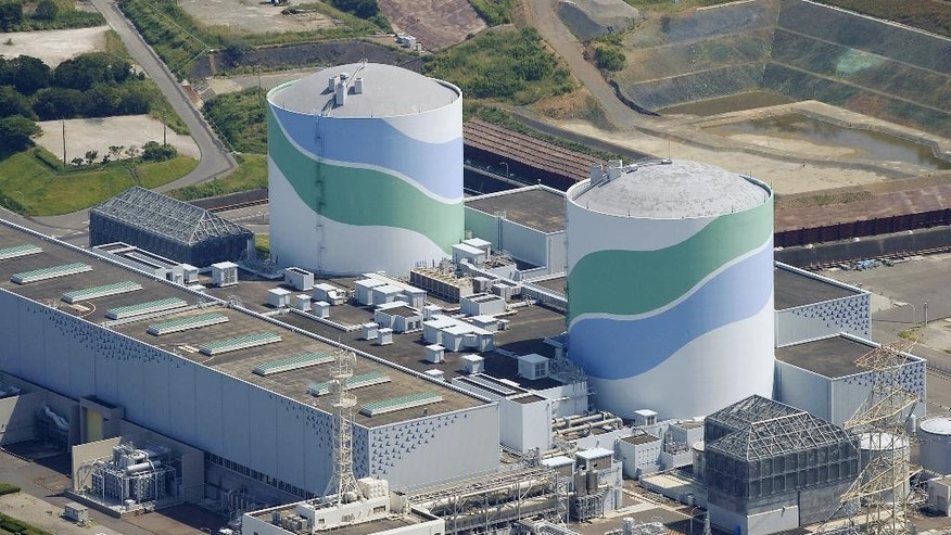 This aerial photo shows reactors of No. 1, right, and No. 2, left,  at the Sendai Nuclear Power Station in Satsumasendai, Kagoshima prefecture, southern Japan, Tuesday, Aug. 11, 2015.  Kyushu Electric Power Co. said Tuesday, Aug. 11, 2015,  it had restarted the No. 1 reactor at its Sendai nuclear plant as planned. The restart marks Japan's return to nuclear energy four-and-half-years after the 2011 meltdowns at the Fukushima Dai-ichi nuclear power plant in northeastern Japan following an earthquake and tsunami.(Kyodo News via AP) JAPAN OUT, MANDATORY CREDIT