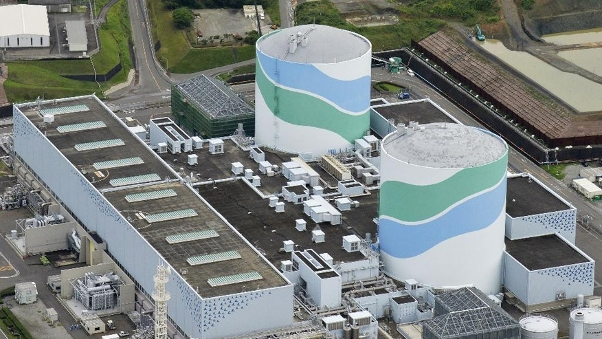 July 7, 2015 - FILE photo shows reactors of No. 1, right, and No. 2 at the Sendai Nuclear Power Station in Satsumasendai, Kagoshima prefecture, southern Japan.  Kyushu Electric Power Co. said it will restart the No. 1 reactor at its Sendai nuclear plant Tuesday morning, Aug. 11.