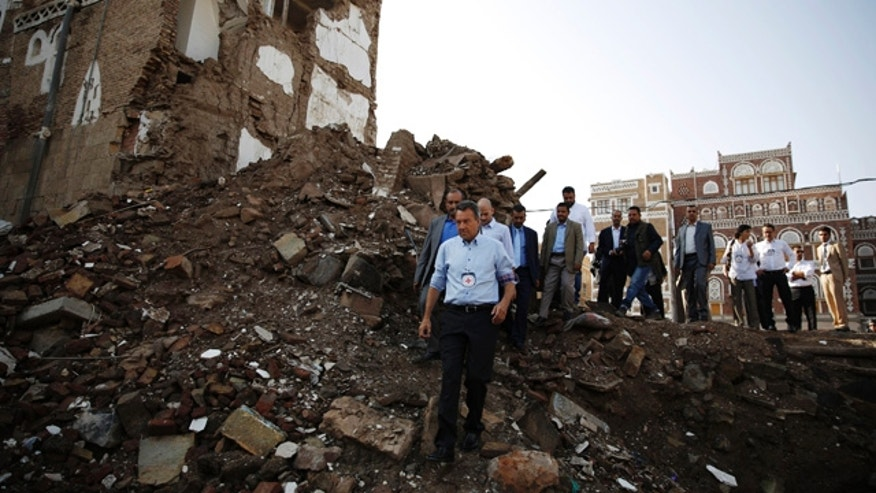 Aug. 9, 2015: Peter Maurer, the president of the International Committee of the Red Cross, center, walks near houses destroyed by a Saudi-led airstrike during his visit to the old city of Sanaa, Yemen. (AP Photo/Hani Mohammed)