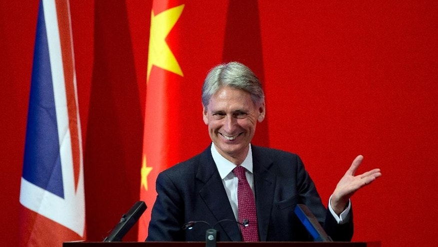 British Foreign Secretary Philip Hammond reacts to a question from a Chinese student during a dialogue session at Peking University in Beijing Wednesday, Aug. 12, 2015. Hammond said Wednesday that an international agreement to limit Iran's nuclear program could give impetus to efforts aimed at curbing North Korea's nuclear weapons program. Hammond, who is in Beijing for talks on security cooperation and climate change, made the comments during a speech to students at the elite university. He is to meet with Chinese senior foreign policy adviser Yang Jiechi on Thursday and visit an Airbus assembly plant in Tianjin. (AP Photo/Andy Wong)