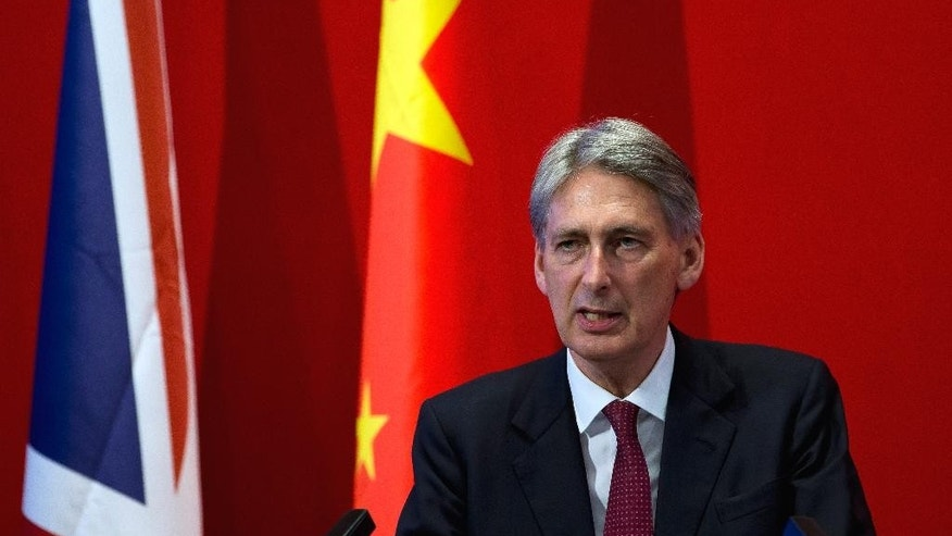 British Foreign Secretary Philip Hammond delivers his speech at Peking University in Beijing Wednesday, Aug. 12, 2015. Hammond said Wednesday that an international agreement to limit Iran's nuclear program could give impetus to efforts aimed at curbing North Korea's nuclear weapons program. (AP Photo/Andy Wong)