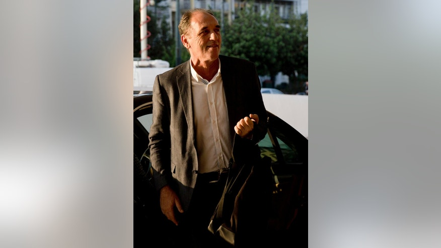 Greece's Economy Minister Giorgos Stathakis arrives at a hotel to continue talks with bailout negotiators, in central Athens, Monday, Aug. 10, 2015. Athens and the negotiators are hoping to conclude talks Tuesday for a third bailout package. (AP Photo/Petros Giannakouris)