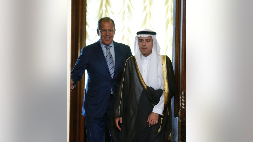 Russian Foreign Minister Sergey Lavrov, left, and Saudi Arabia Foreign Minister Adel bin Ahmed Al-Jubeir, enter a hall for  their meeting in Moscow, Russia, Tuesday, Aug. 11, 2015. The talks are part of a new Moscow attempt to help mediate the Syrian conflict. (AP Photo/Alexander Zemlianichenko)