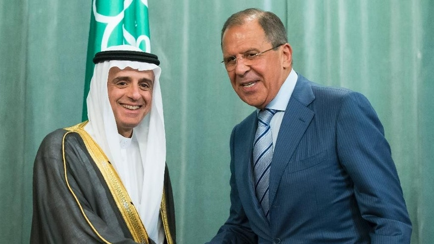 Russian Foreign Minister, Sergey Lavrov, right, and Saudi Arabia Foreign Minister, Adel bin Ahmed Al-Jubeir, shake hands after a news conference following their meeting in Moscow, Russia, Tuesday, Aug. 11, 2015.  Pressing to mediate the Syrian conflict, Russia on Tuesday hosted the Saudi foreign minister for talks that revealed their sharp differences about the fate of Syrian President Bashar Assad. (AP Photo/Alexander Zemlianichenko)