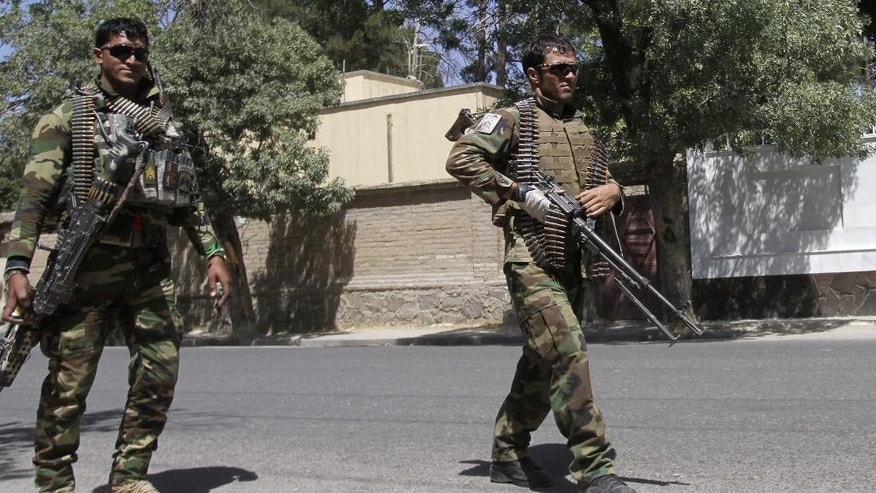 Afghanistan's National Army soldiers patrol in Herat, west of Kabul, Afghanistan, Wednesday, Aug. 12, 2015. The Taliban issued a statement about the fighting giving a much higher figure for police casualties. The insurgents regularly exaggerate their gains. (AP Photo/Hoshan Hashimi)