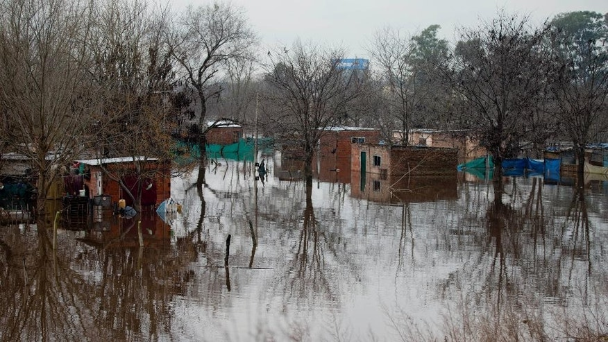 Homes are flooded in Lujan, Argentina, Tuesday, Aug. 11, 2015. Overflowing rivers and streets turned into waterways are prompting the evacuation of large numbers of people in the province of Buenos Aires after several days of heavy rain. (AP Photo/Natacha Pisarenko)