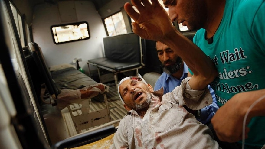 An elderly Kashmiri man is placed on a stretcher for treatment at a hospital in Srinagar, Indian-controlled Kashmir, Thursday, Aug. 13, 2015. An explosion outside a mosque prayer hall early Thursday wounded less than a dozen worshippers in the insurgency-wracked Indian portion of Kashmir, police said. (AP Photo/Mukhtar Khan)