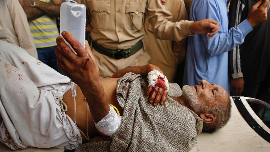 An elderly Kashmiri man is carried on a stretcher for treatment at a hospital in Srinagar, Indian-controlled Kashmir, Thursday, Aug. 13, 2015. An explosion outside a mosque prayer hall early Thursday wounded less than a dozen worshippers in the insurgency-wracked Indian portion of Kashmir, police said. (AP Photo/Mukhtar Khan)