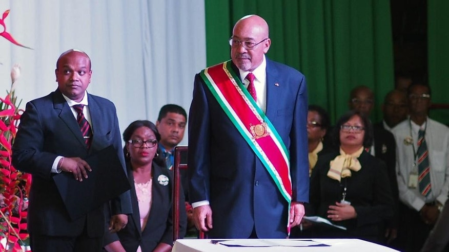 Suriname's President Desi Bouterse, re-elected to a second, five-year term, attends his swearing-in ceremony in Paramaribo, Suriname, Wednesday, Aug. 12, 2015. A  two-time coup leader and former dictator accused of executing 15 political opponents in 1982, Bouterse, obtained immunity as head of state when he was democratically elected in 2010 amid widespread discontent with Suriname's economy. (AP Photo/Ertugrul Kilic)