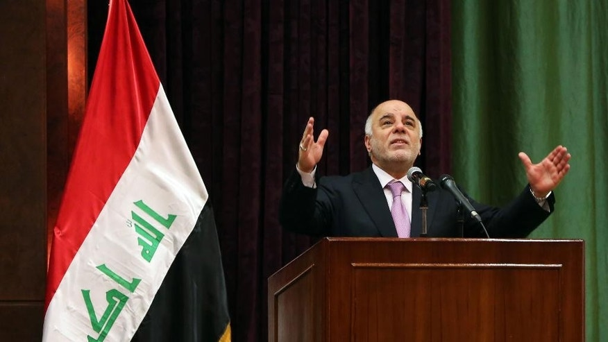Iraqi Prime Minister Haider al-Abadi addresses the media during the International Youth Day celebration in Baghdad, Iraq, Wednesday, Aug. 12, 2015.  Iraq's parliament on Tuesday unanimously approved an ambitious reform plan that would cut spending and eliminate senior posts, including the three largely symbolic vice presidencies, following mass protests against corruption and poor services. (AP Photo/Karim Kadim)
