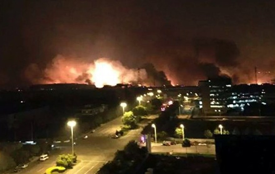 Aug. 13, 2015: In this photo released by Xinhua News Agency smoke and fire erupt into the night sky after an explosion in the Binhai New Area in north China's Tianjin Municipality. Chinese state media reported huge explosions at the Tianjin port late Wednesday with large numbers of people reported injured.