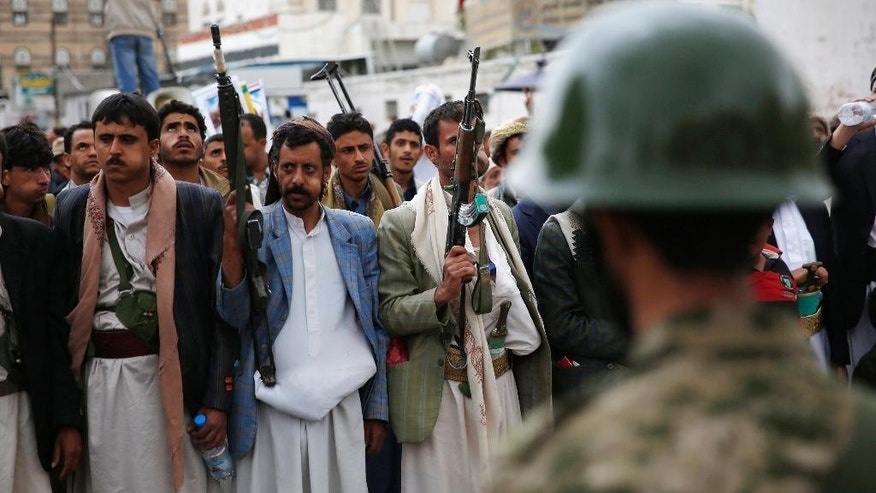 Shiite rebels known as Houthis holds their weapons during a rally against Saudi-led airstrikes in Sanaa, Yemen, Tuesday, Aug. 11, 2015. (AP Photo/Hani Mohammed)