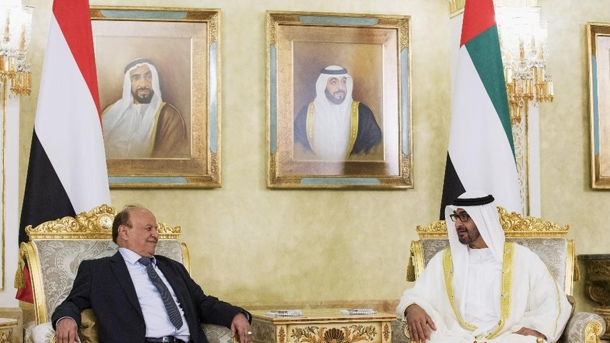 In this photo made available by Emirates News Agency, WAM, Sheikh Mohamed bin Zayed Al Nahyan, Crown Prince of Abu Dhabi and Deputy Supreme Commander of the UAE Armed Forces, right, receives Yemen's exiled President Abed Rabbo Mansour Hadi at the Presidential Airport in Abu Dhabi, United Arab Emirates, Wednesday, Aug. 12, 2015. (Mohamed Al Hammadi/Crown Prince Court - Abu Dhabi via AP )
