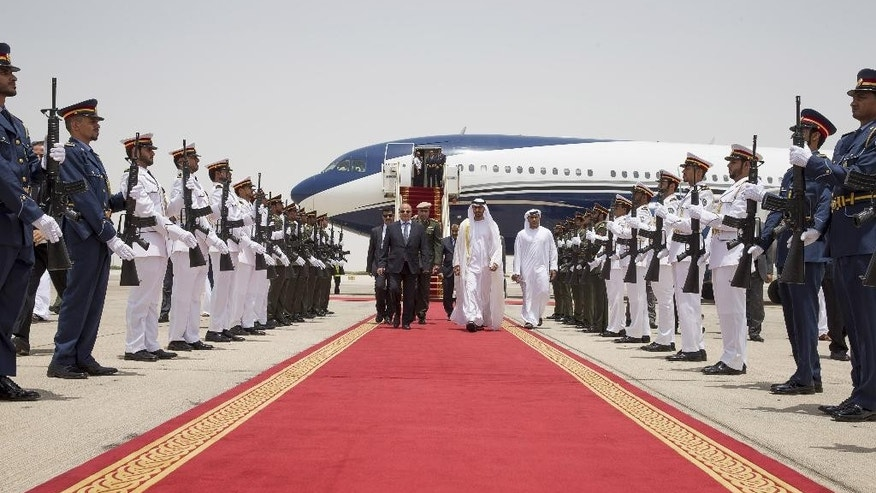 In this photo made available by Emirates News Agency, WAM, Sheikh Mohamed bin Zayed Al Nahyan, Crown Prince of Abu Dhabi and Deputy Supreme Commander of the UAE Armed Forces, center right, receives Yemen's exiled President Abed Rabbo Mansour Hadi, center left, at the Presidential Airport in Abu Dhabi, United Arab Emirates, Wednesday, Aug. 12, 2015. (Mohamed Al Hammadi/Crown Prince Court - Abu Dhabi via AP )