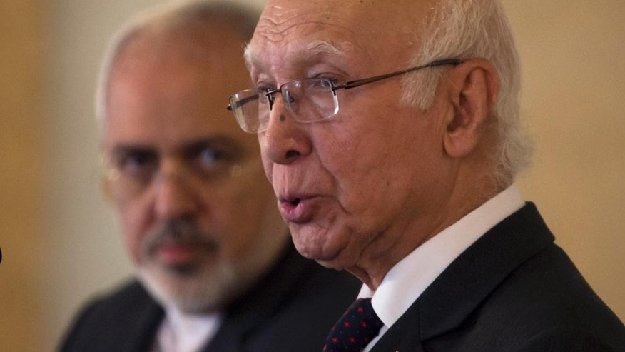 Pakistan's Prime Minister's Adviser on Foreign Affairs Sartaj Aziz, right, speaks at a joint news conference as visiting Iranian Foreign Minister, Mohammad Javad Zarif, looks on at the Foreign Ministry in Islamabad, Pakistan, Thursday, Aug. 13, 2015. (AP Photo/B.K. Bangash)