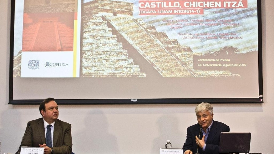 Rene Chavez, right, researcher at the Institute of Geophysics of the National Autonomous University of Mexico, (UNAM), speaks next to Arturo Iglesias, director of the Institute, during a press conference in Mexico City, Thursday, Aug. 13, 2015. Researchers at the UNAM found that the Kukulcan pyramid in the archaeological site of Chichen Itza is built on a cenote or a water filled sinkhole. (AP Photo/Esteban Felix)