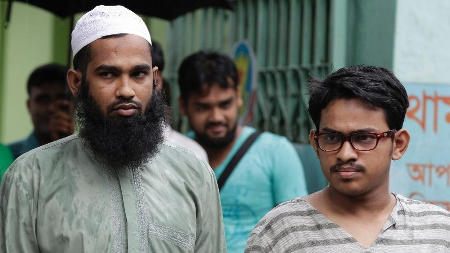 Suspected Muslim militants Saad-al-Nahin, right, and Masud Rana, who were arrested in the last week's killing of a secular blogger, stand before the media in Dhaka, Bangladesh, Friday, Aug. 14, 2015. Dhaka Metropolitan Police spokesman Muntasirul Islam said that the two, suspected members of Ansarullah Bangla Team, a group blamed for some of the previous attacks on bloggers, were arrested in the fourth such deadly attack this year Thursday evening by the detective branch, which has been handling the case rather than regular police. (AP Photo/A.M. Ahad)