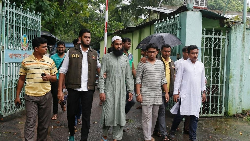 Suspected Muslim militants Saad-al-Nahin, foreground second right, and Masud Rana, foreground third left, who were arrested in the last week's killing of a secular blogger, are escorted to appear before the media in Dhaka, Bangladesh, Friday, Aug. 14, 2015. Dhaka Metropolitan Police spokesman Muntasirul Islam said that the two, suspected members of Ansarullah Bangla Team, a group blamed for some of the previous attacks on bloggers, were arrested in the fourth such deadly attack this year Thursday evening by the detective branch, which has been handling the case rather than regular police. (AP Photo/A.M. Ahad)