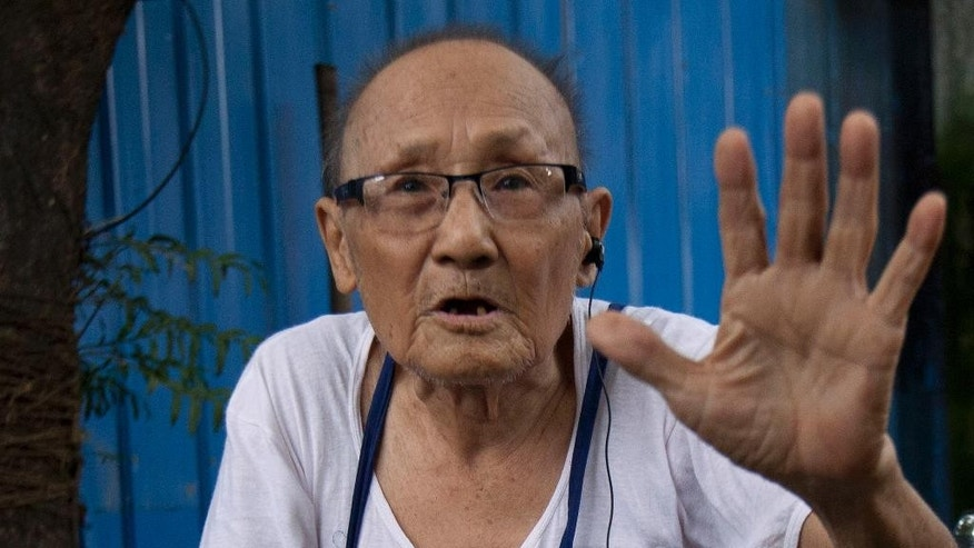 "In this Aug. 12, 2015, photo, World War II veteran Saw Berny, who is ethnic Karen, talks during an interview with the Associated Press in Yangon, Myanmar. Seventy years after World War II ended, withered and mostly impoverished veterans will gather at the graveside of a British officer who almost no one in England remembers. Maj. Hugh Paul Seagrim _ or ""Grandfather Longlegs"" _ remains a legend up in the hills of Myanmar, among a beleaguered ethnic minority for whom peace never came. (AP Photo/Khin Maung Win)"
