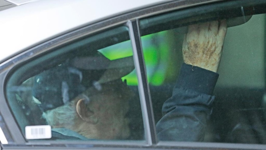 "Greville Janner is driven into Westminster Magistrates Court in London, Friday, Aug. 14, 2015. Lord Janner had been ordered to face a ""trial of the facts"" to be held before a judge and jury. Janner, who has dementia, was ordered to attend in person over 22 alleged child sex offences he is accused of committing in the 1960s, 1970s and 1980s. At a previous hearing on August 7 his lawyers unsuccessfully argued he was too ill to appear.(AP Photo/Frank Augstein)"