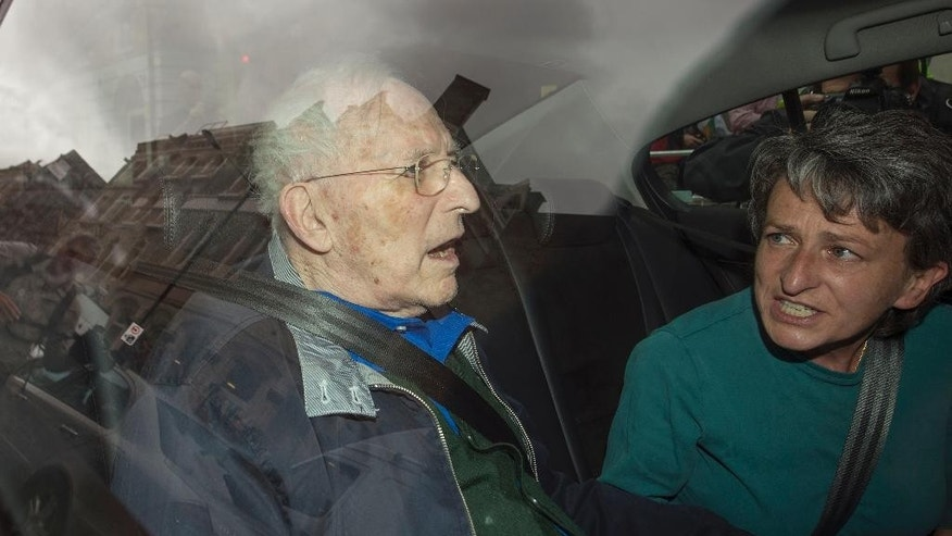 "Greville Janner, left, is driven from Westminster Magistrates Court in London, Friday, Aug. 14, 2015, with unidentified person at right. Lord Janner had been ordered to face a ""trial of the facts"" to be held before a judge and jury. Janner, who has dementia, was ordered to attend in person over 22 alleged child sex offences he is accused of committing in the 1960s, 1970s and 1980s. At a previous hearing on August 7 his lawyers unsuccessfully argued he was too ill to appear. (Anthony Devlin  / PA via AP) UNITED KINGDOM OUT - NO SALES - NO ARCHIVES"