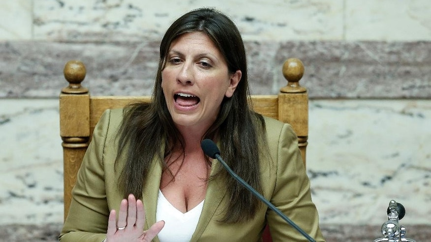 Speaker of Parliament Zoe Konstantopoulou speaks to lawmakers during a debate in Athens, early Friday, Aug. 14, 2015. The Greek government defended its new bailout program in tumultuous parliamentary sessions Friday, as it faced a rebellion in the governing Syriza party ahead of a vote on the deal. (AP Photo/Yannis Liakos)