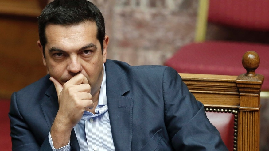 Aug. 14, 2015: Greek Prime Minister Alexis Tsipras liestens during a parliamentary session in Athens.
