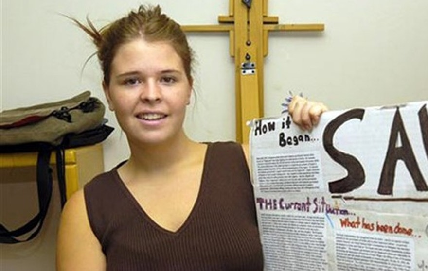 May 30, 2013: In this photo, Kayla Mueller is shown after speaking to a group in Prescott, Ariz. The parents of the late American hostage Kayla Mueller say they were told by American officials that their daughter was repeatedly forced to have sex with Abu Bakr Baghdadi, the leader of the Islamic State group.
