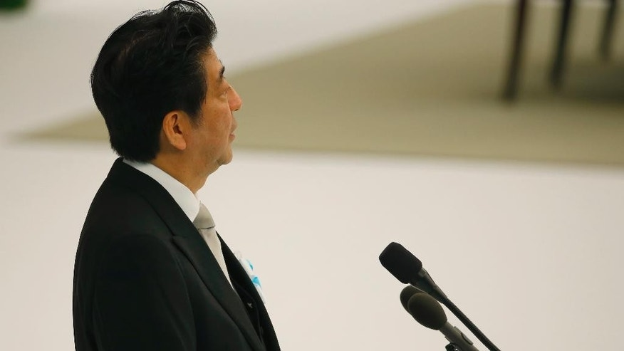 Japanese Prime Minister Shinzo Abe delivers his remarks during a memorial service at Nippon Budokan martial arts hall in Tokyo, Saturday, Aug. 15, 2015. Japan marked Saturday the 70th anniversary of the end of World War II. (AP Photo/Shizuo Kambayashi)