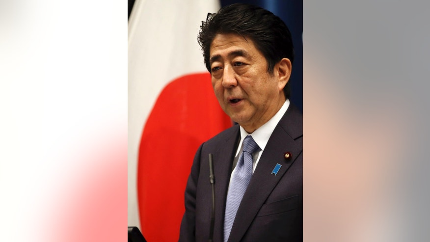 "Japanese Prime Minister Shinzo Abe delivers a statement to mark the 70th anniversary of the end of World War II during a press conference at his official residence in Tokyo Friday, Aug. 14, 2015. Abe has expressed ""profound grief"" for all who perished in World War II in a statement marking the 70th anniversary of the country's surrender. Abe acknowledged that Japan inflicted ""immeasurable damage and suffering"" on innocent people in the war. He also expressed apologies for Japan's actions. (AP Photo/Eugene Hoshiko)"