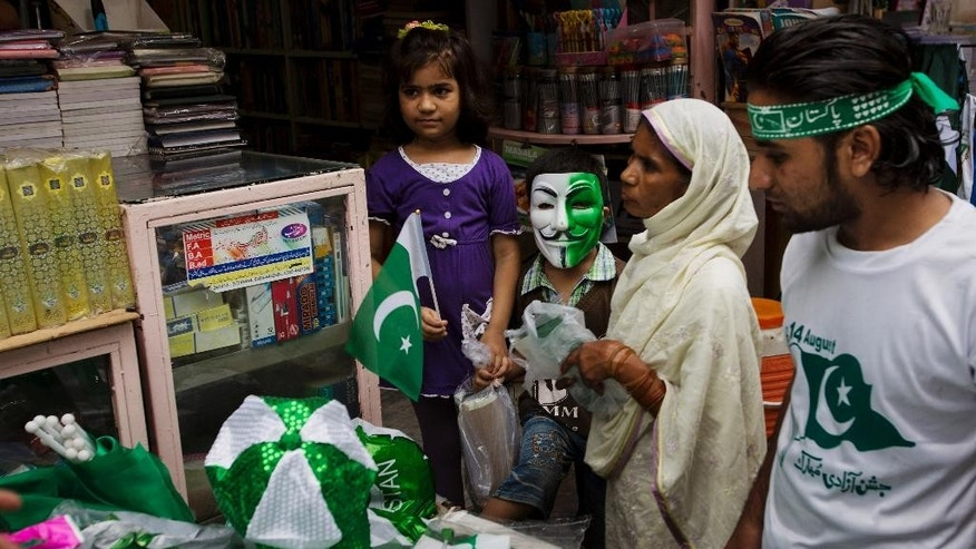 People buy flags to celebrate the country's upcoming 69th Independence Day in Rawalpindi, Pakistan, Thursday, Aug. 13, 2015. Millions of Pakistanis will hold rallies for Independence Day on Friday to commemorate its independence in 1947 from British colonial rule.(AP Photo/B.K. Bangash)