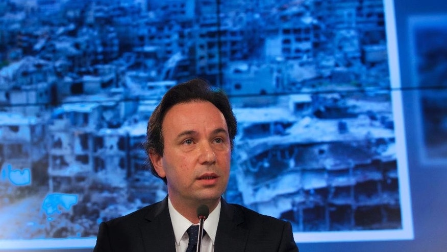 "Syrian National Coalition President Khaled Khoja attends a news conference in Moscow, Russia, on Friday, Aug. 14, 2015. Speaking a day after talks with Russian Foreign Minister Sergey Lavrov, Khoja said Friday that ""the Russian leadership isn't clinging to Bashar Assad"" and is focusing on the need to preserve Syria's territorial integrity and prevent it from collapsing. (AP Photo/Ivan Sekretarev)"