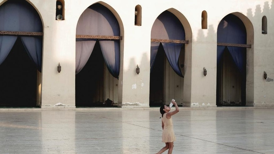 "A girl drinks water inside the Al-Hakim bi-Amr Allah Mosque on Al Muezz street in Cairo, Egypt, Thursday, Aug. 13, 2015. Egypt's health minister on Thursday said 17 more people have died due to an ""unprecedented"" heat wave, raising this week's death toll to more than 70. (AP Photo/Nariman El-Mofty)"