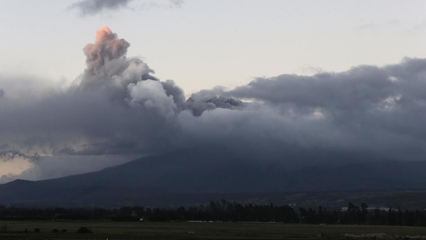 A view of Cotopaxi volcano spewing ashes as seen from Latacunga, Ecuador, Saturday, Aug. 15, 2015.  The Cotopaxi volcano near Ecuador's capital has spewed ash over a wide area in pre-dawn blasts. The volcano is considered one of the world's most dangerous volcanoes due to a glacial cover that makes it prone to mud flows and its proximity to a heavily populated area, but government scientists say that the snow-capped volcano doesn't seem to be on the verge of a major eruption. Its last major eruption was in 1877. (AP Photo/Dolores Ochoa)