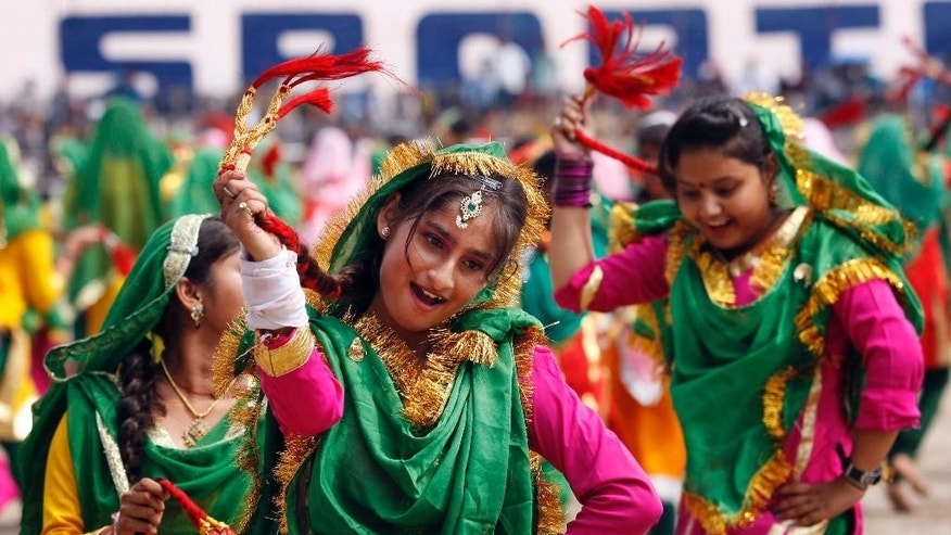 School girls, dressed in traditional attire, perform on the occasion of 69th anniversary of India's independence from British rule, in Jammu, India, Saturday, Aug. 15, 2015. (AP Photo/Channi Anand)