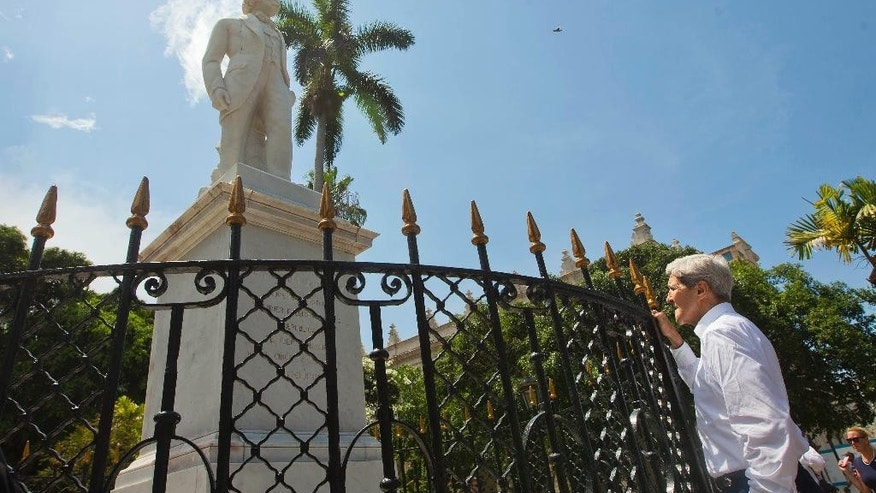 Secretary of State John Kerry stops to get a closer looks at a statue of Jose Marti, a Cuban National hero, during his visit to the Plaza de Armas in Old Havana, Cuba, Friday, Aug. 14, 2015. Kerry traveled to the Cuban capital to raise the U.S. flag and formally reopen the long-closed U.S. Embassy. Cuba and U.S. officially restored diplomatic relations July 20, as part of efforts to normalize ties between the former Cold War foes. (AP Photo/Pablo Martinez Monsivais,Pool)