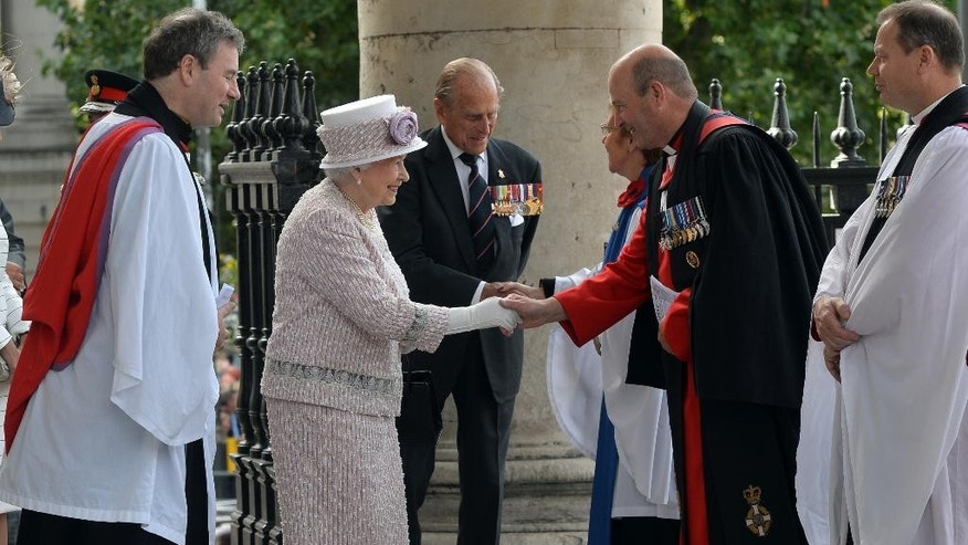 Britain's Queen Elizabeth II, centre and Philip, the Duke of Edinburgh arrive at St Martin-in-the-Fields, in London for a service of commemoration marking the 70th anniversary of VJ Day, Saturday Aug. 15, 2015. Queen Elizabeth II is leading ceremonies in Britain to mark the 70th anniversary of the victory over Japan during World War II. (Hannah McKay/PA via AP) UNITED KINGDOM OUT
