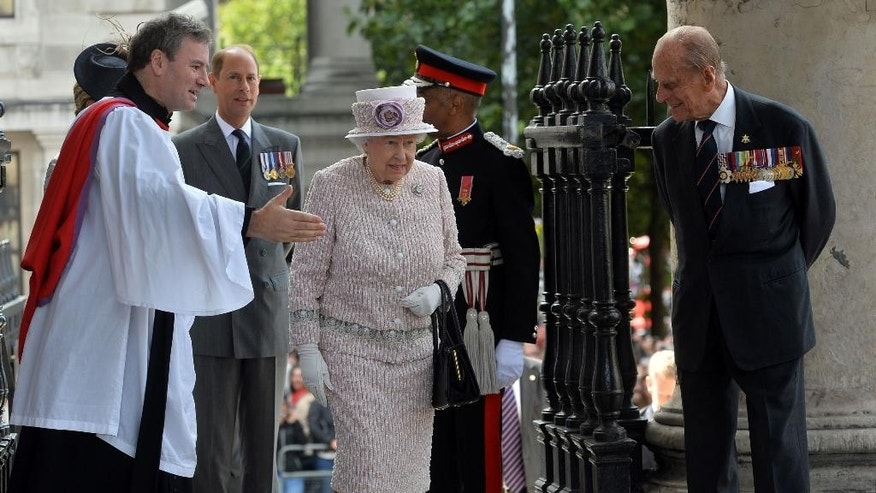 Britain's Queen Elizabeth II, centre and Philip, the Duke of Edinburgh arrive at St Martin-in-the-Fields, in London for a service of commemoration marking the 70th anniversary of VJ Day, Saturday Aug. 15, 2015. Queen Elizabeth II is leading ceremonies in Britain to mark the 70th anniversary of the victory over Japan during World War II. In the background is Prince Edward, the Earl of Wessex. (Hannah McKay/PA via AP) UNITED KINGDOM OUT