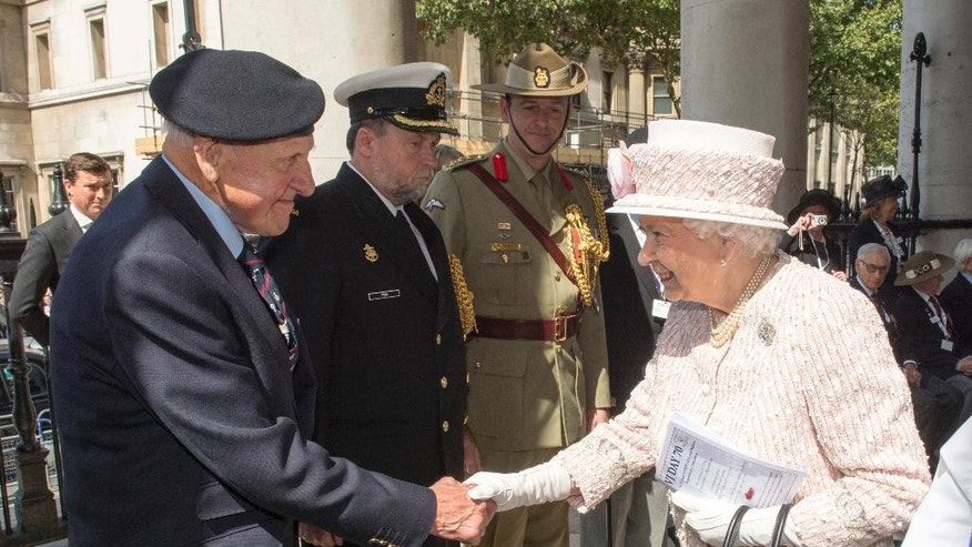 Britain's Queen Elizabeth II , meets WWII veteran Robert Hucklesbury, at St  Martin-in-the-Fields Church, in London, as they attend a service of commemoration marking the 70th anniversary of VJ Day, Saturday Aug. 15, 2015. Queen Elizabeth II is leading ceremonies in Britain to mark the 70th anniversary of the victory over Japan during World War II. (Arthur Edwards/Pool Photo via AP)
