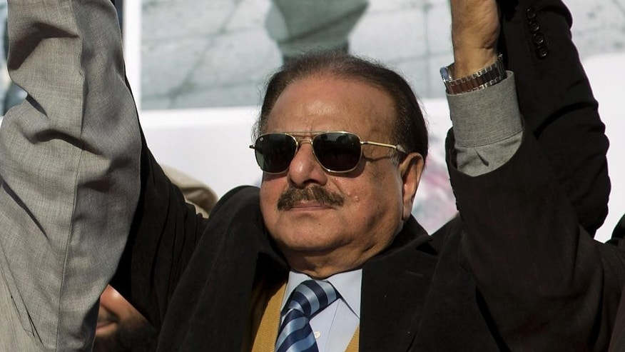 FILE - In this Feb. 5, 2015 file photo, former chief of Pakistan Inter Services Intelligence (ISI), Hameed Gul attends a rally to mark Kashmir Day in Islamabad, Pakistan. Family members say on Sunday, Aug. 16, 2015 Hameed Gul, the former head of Pakistan's Inter-Services Intelligence spy agency during the end of the Soviet occupation of Afghanistan and who supported Islamic militants, has died of a brain hemorrhage. He was 79. (AP Photo/B.K. Bangash, File)