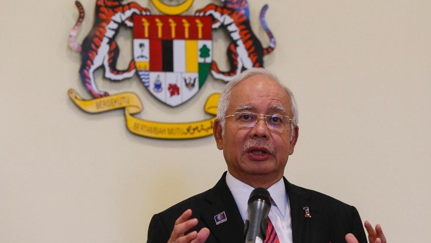 In this Aug. 14, 2015 photo, Malaysian Prime Minister Najib Razak speaks at a press conference in Putrajaya, Malaysia. Razak has a problem: he can's explain away a $700 million bank account to a skeptical public. Less than a month after leaked documents suggested that $700 million from entities linked to debt-ridden state investment fund 1MDB was funneled into Prime Minister Najib Razak's accounts, he has expelled critics in his government, sacked the attorney-general probing him, suspended two newspapers, blocked a UK-based website and stalled investigations over the scandal. (AP Photo/Joshua Paul)