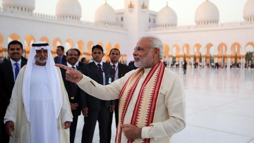Indian Prime Minister Narendra Modi, right, visits the Sheikh Zayed Grand Mosque with Sheikh Hamdan bin Mubarak Al Nahyan, UAE Minister of Higher Education and Scientific Research, second left, during the first day of a  two-day visit to the UAE, in Abu Dhabi, United Arab Emirates, Sunday, Aug. 16, 2015. The UAE is home to over two million Indian expatriates and this is the first visit by an Indian premier in over three decades. (AP Photo/Kamran Jebreili)