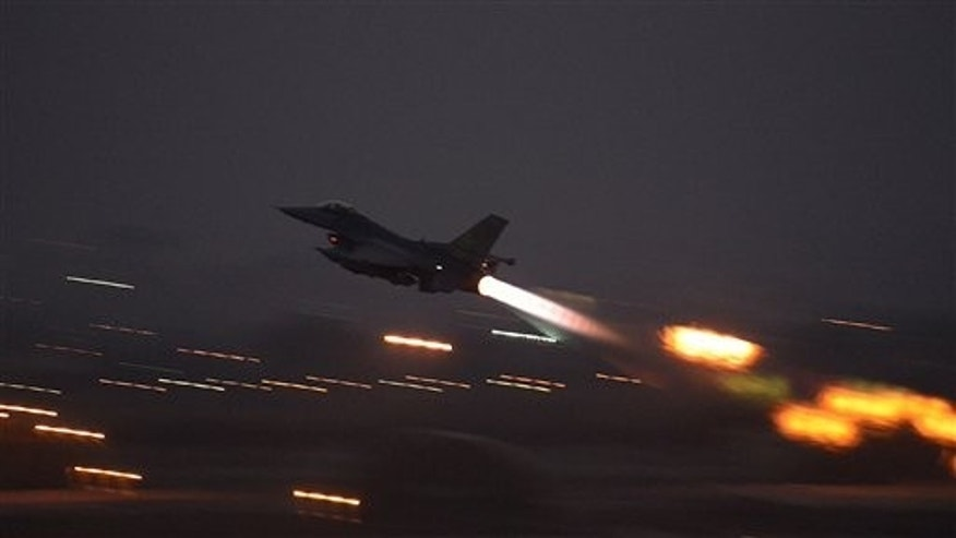 In this image provided by the U.S. Air Force, an F-16 Fighting Falcon takes off from Incirlik Air Base, Turkey, as the U.S. on Wednesday, Aug. 12, 2015, launched its first airstrikes by Turkey-based F-16 fighter jets against Islamic State targets in Syria.  (Krystal Ardrey/U.S. Air Force via AP))