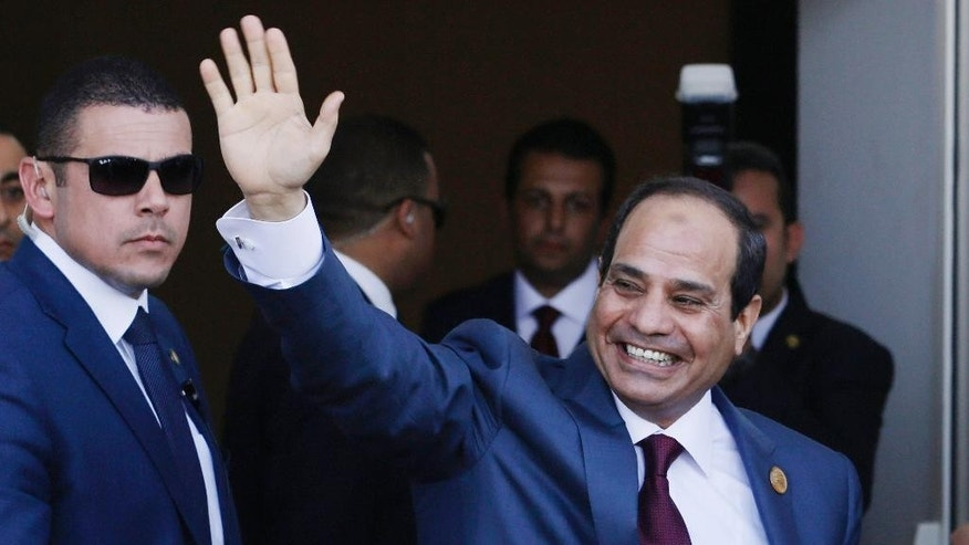 "FILE - In this Aug. 6, 2015 file photo, Egyptian President Abdel-Fattah el-Sissi waves as he arrives to the opening ceremony of the new section of the Suez Canal in Ismailia, Egypt. A new 54-article anti-terrorism bill signed into law by el-Sissi was announced on Monday, Aug. 17, 2015, establishing stiffer prison sentences for offences deemed to be terrorism-related, heavy fines for journalists who publish ""false news"" and a special judicial circuit for terrorism-related cases. Egypt has not had a parliament for over two years, and legislative authority rests with el-Sissi. (AP Photo/Hassan Ammar, File)"