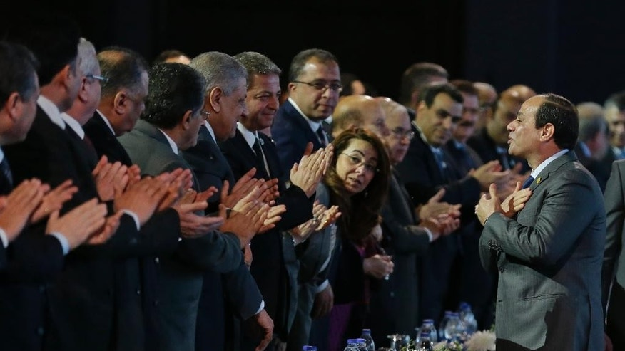 "FILE - In this March 15, 2015 file photo, Egyptian President Abdel-Fattah el-Sissi greets delegates before he speaks during the final day of a major economic conference, in Sharm el-Sheikh, Egypt. A new 54-article anti-terrorism bill signed into law by el-Sissi was announced on Monday, Aug. 17, 2015, establishing stiffer prison sentences for offences deemed to be terrorism-related, heavy fines for journalists who publish ""false news"" and a special judicial circuit for terrorism-related cases. Egypt has not had a parliament for over two years, and legislative authority rests with el-Sissi. (AP Photo/Hassan Ammar, File)"