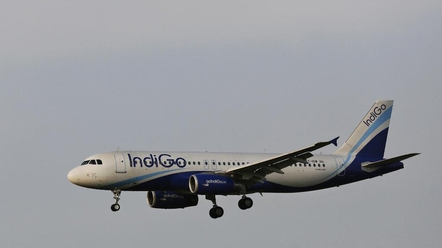 FILE- This April 16, 2015 file photo shows an India's budget airline IndiGo aircraft approaching for landing at the Indira Gandhi International (IGI) airport in New Delhi, India. Indian budget airline IndiGo finalized an exceptionally large order for 250 single-aisle Airbus A320neo jets on Monday, Aug. 17, 2015 to keep up with rapid growth in the country's air travel.(AP Photo/Altaf Qadri, file)