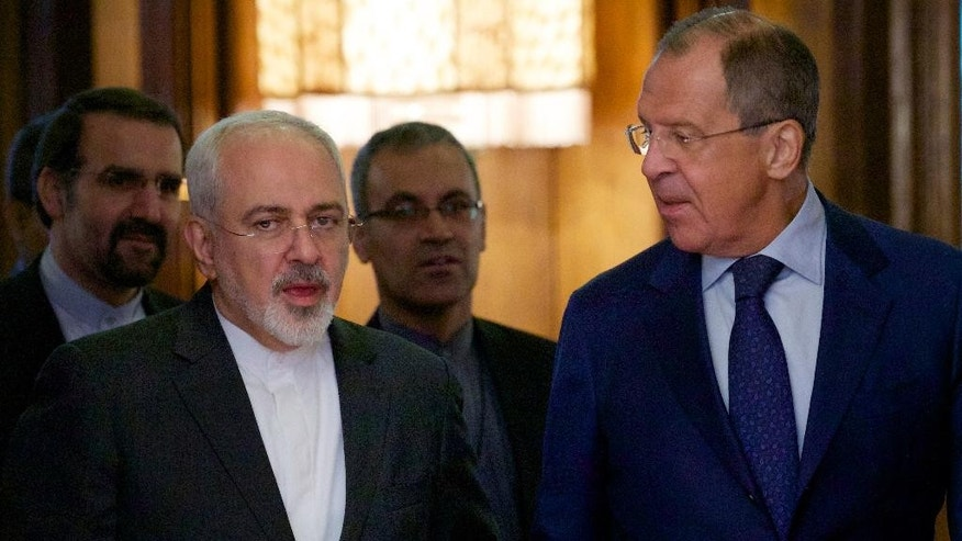 Iranian Foreign Minister Mohammad Javad Zarif, left, chats with Russian Foreign Minister Sergey Lavrov upon being welcomed by Lavrov for their meeting in Moscow, Russia, on Monday, Aug. 17, 2015. The two are holding talks expected to focus on the implementation of the nuclear deal between Tehran and world powers, as well as international efforts to mediate the conflict in Syria. (AP Photo/Ivan Sekretarev)