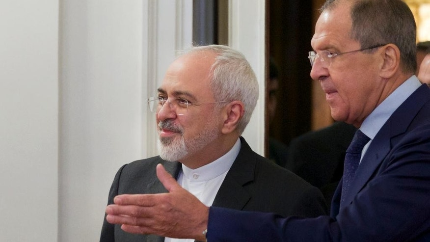 Russian Foreign Minister Sergey Lavrov, right, welcomes his Iranian counterpart Mohammad Javad Zarif at their meeting in Moscow, Russia Monday, Aug. 17, 2015. The two are holding talks expected to focus on the implementation of the nuclear deal between Tehran and world powers, as well as international efforts to mediate the conflict in Syria. (AP Photo/Ivan Sekretarev)