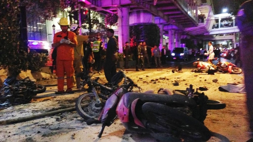 Motorcycles are strewn about after an explosion in Bangkok, Monday, Aug. 17, 2015. A large explosion rocked a central Bangkok intersection during the evening rush hour, killing a number of people and injuring others, police said. (AP Photo/Jerry Harmer)
