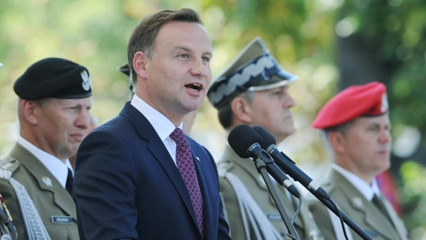 Polish President Andrzej Duda speaks during Polish Army Day celebrations in Warsaw, Poland, Saturday, Aug. 15, 2015. (AP Photo/Alik Keplicz)